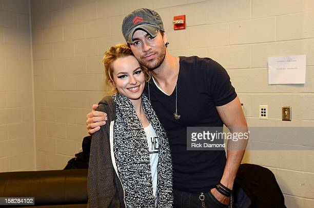 Bridgit Mendler and Enrique Iglesias pose backstage at Power 96.1's Jingle Ball 2012 at the Philips Arena on December 12, 2012 in Atlanta.