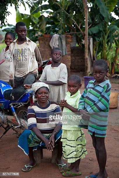 Bridjet Mbahiga with her children She is mother of 4 and runs a subsistence plot of land to feed the kids yams agash and rice Benue state has got one...