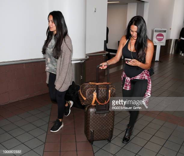 Brie Bella and Nikki Bella are seen at LAX on July 26 2018 in Los Angeles California