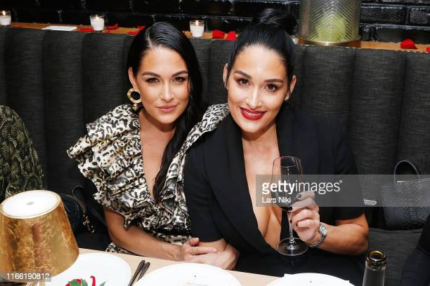 Brie Bella and Nikki Bella attend the Beauty moguls Nikki and Brie Bella's launch of their new product line during fashion week for Nicole and Brizee...