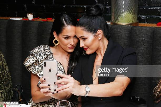 Brie Bella and Nikki Bella take a selfie during the launch of their new product line during fashion week for Nicole and Brizee NB body and beauty...