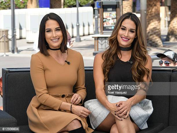 Brie Bella and Nikki Bella visit 'Extra' at Universal Studios Hollywood on October 3 2016 in Universal City California