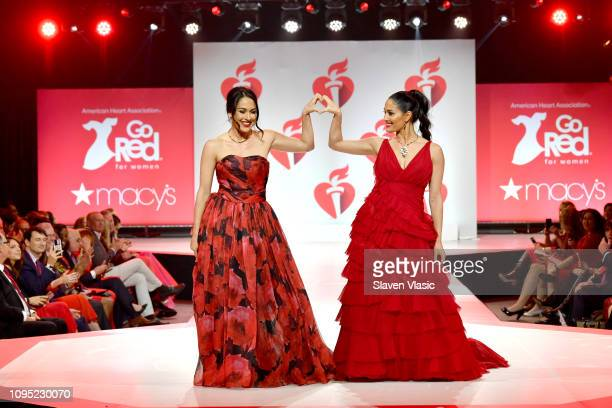 Brie Bella and Nikki Bella walk the runway for The American Heart Association's Go Red For Women Red Dress Collection 2019 Presented By Macy's at...