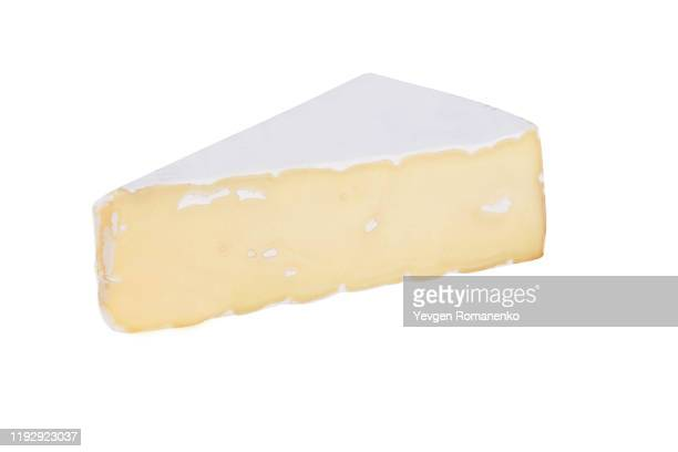 brie cheese isolated on white background - brie stockfoto's en -beelden