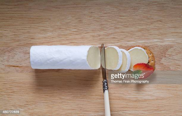 brie cheese log and cracker with strawberry -  firak stock pictures, royalty-free photos & images