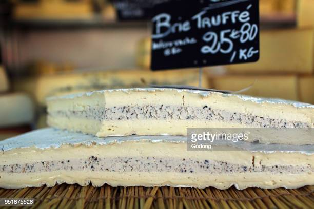 Brie cheese truffle for sale on market stall