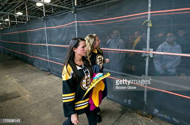 Brie Connolly of West Newbury front and Kayla MacLeod of Merrimac Mass looked through the ticket line for a friend who was buying tickets for them...
