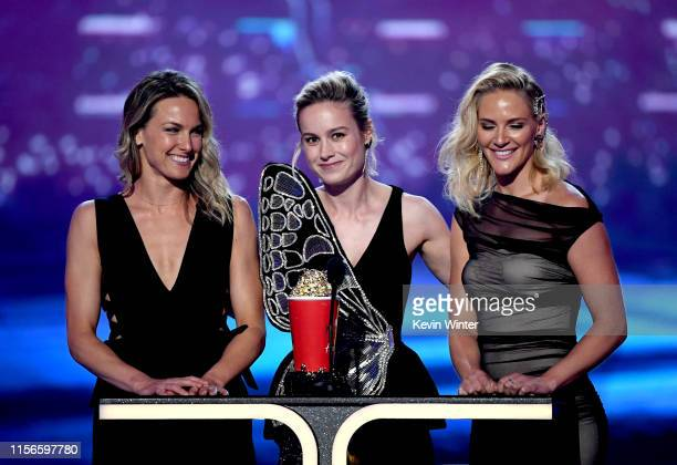 Brie Larson and stunt doubles Ingrid Kleinig and Joanna Bennett accept the Best Fight award for 'Captain Marvel' onstage during the 2019 MTV Movie...