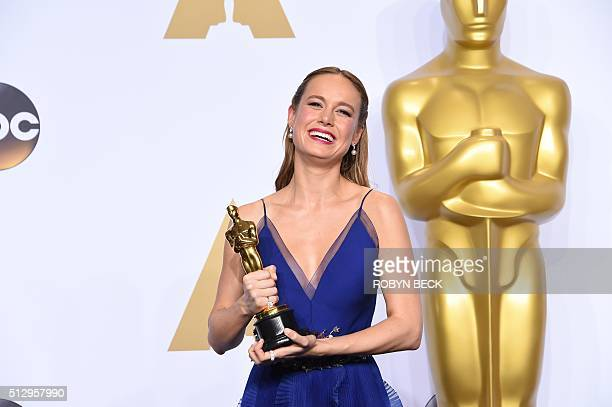 Brie Larson poses with the Oscar for Best Actress 'Room' in the press room during the 88th Oscars on February 28 2016 in Hollywood AFP PHOTO/ROBYN...
