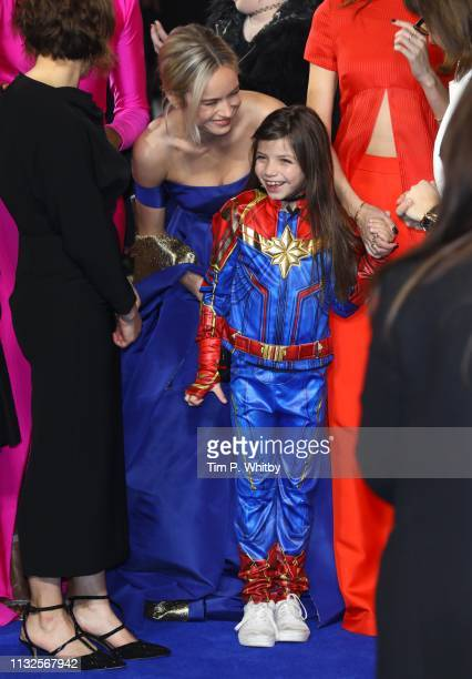 Brie Larson with a young fan as she attends the Captain Marvel European Gala Premiere held at The Curzon Mayfair on February 27 2019 in London England