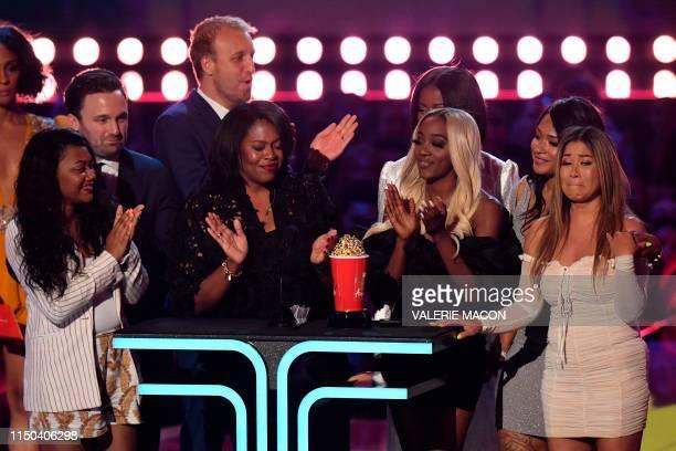 Brie Miranda Bryant Senior VP Unscripted Development and Programming at Lifetime flanked by Asante McGee Lisa VanAllen Lizzette Martinez and Faith...