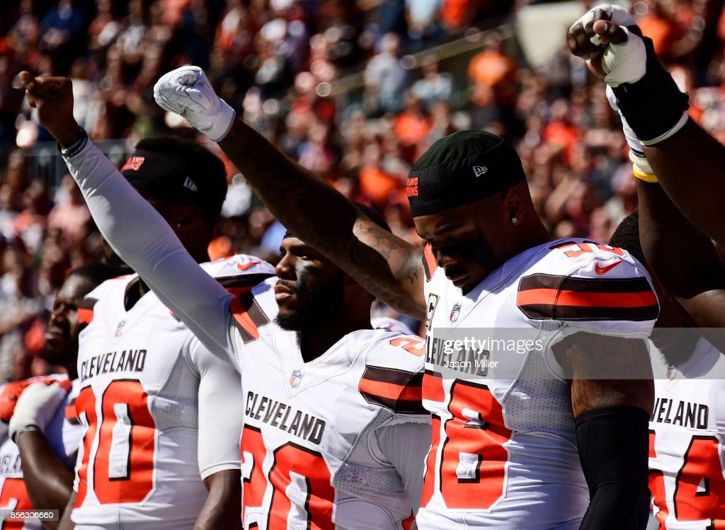 Briean Boddy-Calhoun #20 and Christian Kirksey #58 of the Cleveland Browns hold their fists in the air during the National Anthem before the game against the Cincinnati Bengals at FirstEnergy Stadium on October 1, 2017 in Cleveland, Ohio.