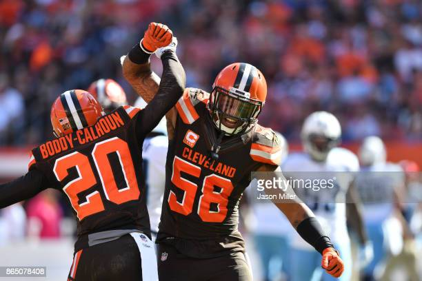 Briean BoddyCalhoun and Christian Kirksey of the Cleveland Browns celebrate after making a third down stop in the first quarter against the Tennessee...