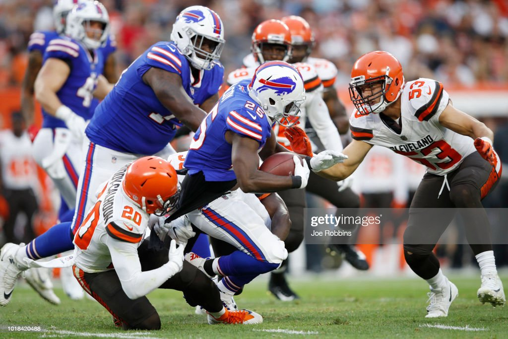 Briean Boddy-Calhoun #20 and Joe Schobert #53 of the Cleveland Browns tackle LeSean McCoy #25 of the Buffalo Bills in the first quarter of a preseason game at FirstEnergy Stadium on August 17, 2018 in Cleveland, Ohio.