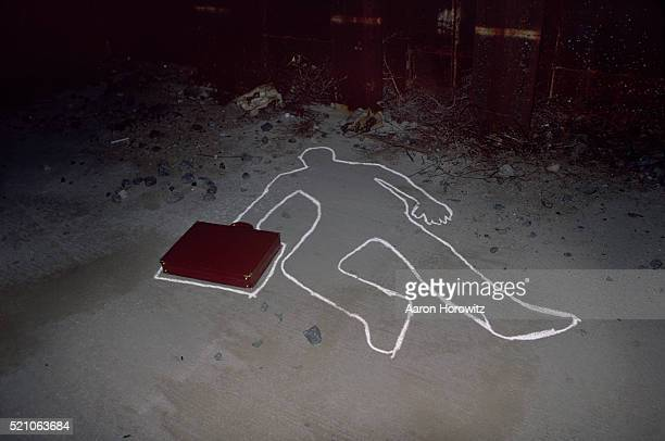 Briefcase and Chalk Outline at Crime Scene