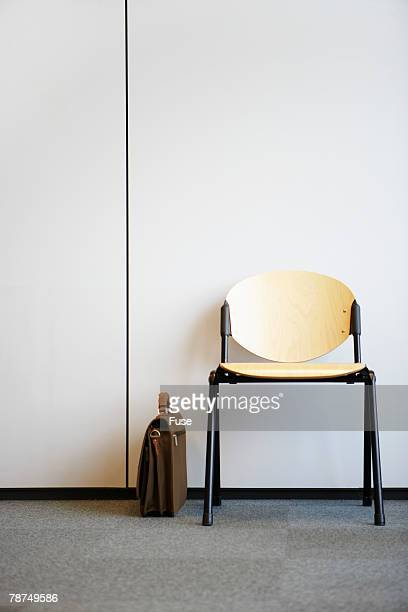 Briefcase Beside Empty Chair