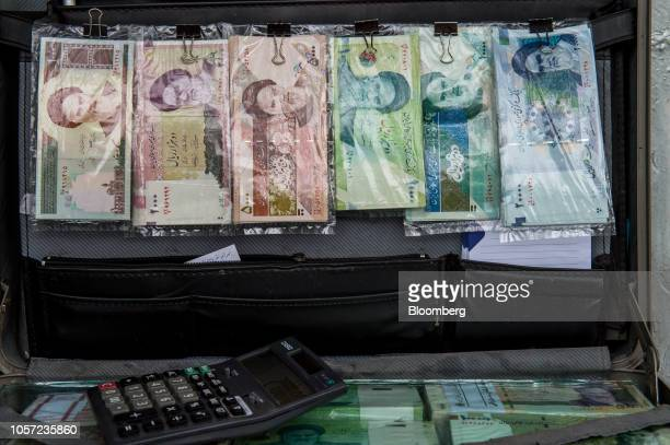 A briefcase filled with Iranian rial banknotes sits on display at a currency exchange in Tehran Iran on Saturday Nov 3 2018 Irans Supreme Leader...
