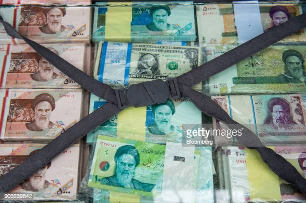 A briefcase filled with Iranian rial banknotes sits on display at a currency exchange market on Ferdowsi street in Tehran Iran on Saturday Jan 6 2018...