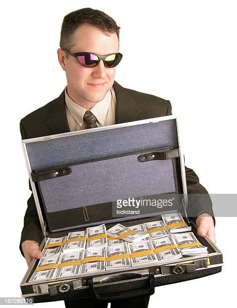 briefcase full of money - con man stock photos and pictures