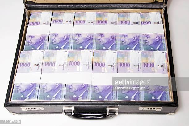 Briefcase full of Swiss francs, bills