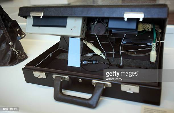 A briefcase hiding infrared camera flashes for taking discreet photographs at night is displayed at the Stasi or East German Secret Police Museum on...