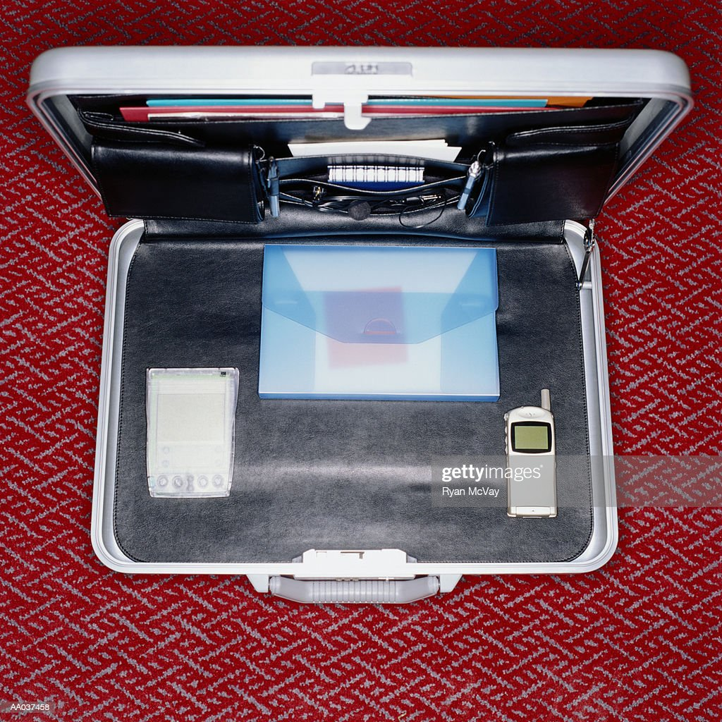 Briefcase with Mobile Phone and Palm top : Stock Photo