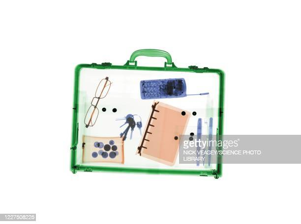 briefcase with various items, x-ray - x ray image stock pictures, royalty-free photos & images