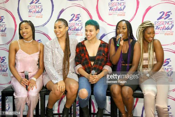 Brienna DeVlugt, Kristal Lyndriette, Gabrielle Carreiro, Ashly Williams and Shyann Roberts of June's Diary pose backstage during the 2019 ESSENCE...