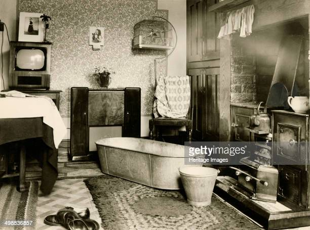 Brierley Cottages Sutton in Ashfield Nottinghamshire c1950s The interior of one of the cottages showing a tin bath and bucket in front of the open...