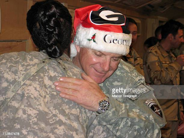 Brig Gen Larry Dudney embraces a soldier in Afghanistan during the Christmas holiday December 25 2009