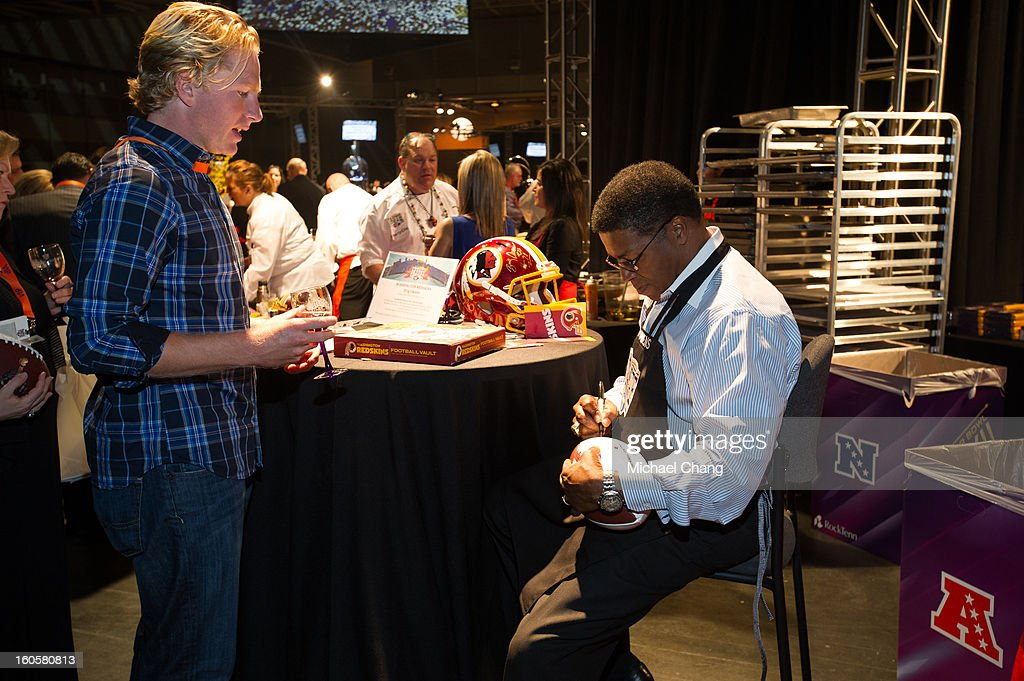 Brig Owens signs a footbal for a fan during the 2013 Taste of the NFL at the Ernest N. Morial Convention Center on February 2, 2013 in New Orleans, Louisiana.