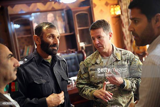 Brigadier General Abdul Hakim Eshaqza provincial chief of police for Logar Province speaks with the US Army Major General Scott Miller commander of...
