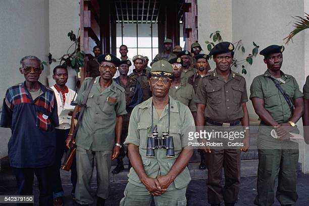 Brigadier General David Nimley commander of President Samuel Doe's Armed Forces of Liberia stands among his troops in Monrovia Responding to years of...
