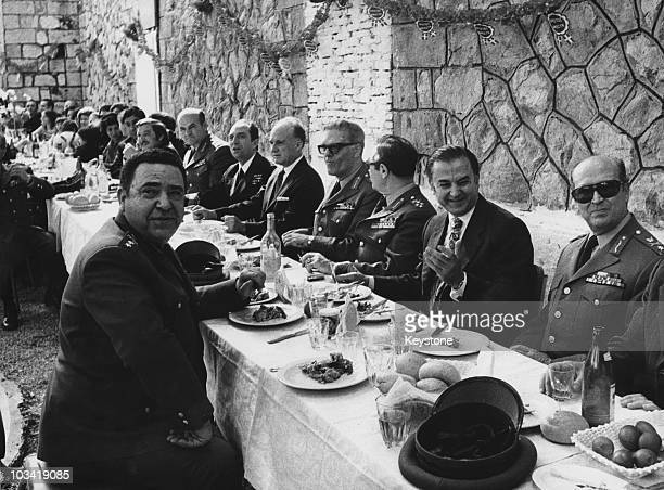 Brigadier General Dimitrios Ioannides at an Easter celebration in Greece following his successful coup d'etat April 1974 From left to right Ioannides...