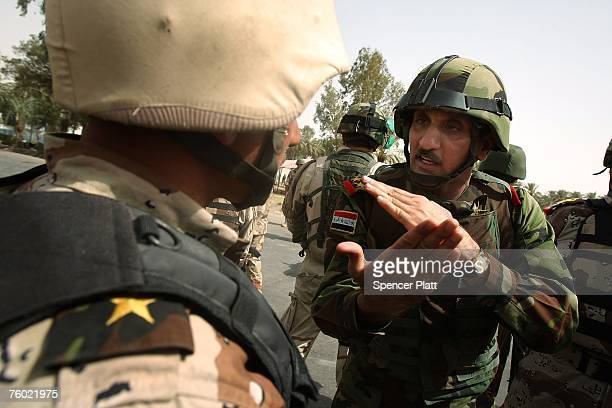 Brigadier General Falleh of the Iraqi Army berates an Iraqi soldier for being to lax at a checkpoint in the Khadamiya nieghborhood August 8 2007 in...