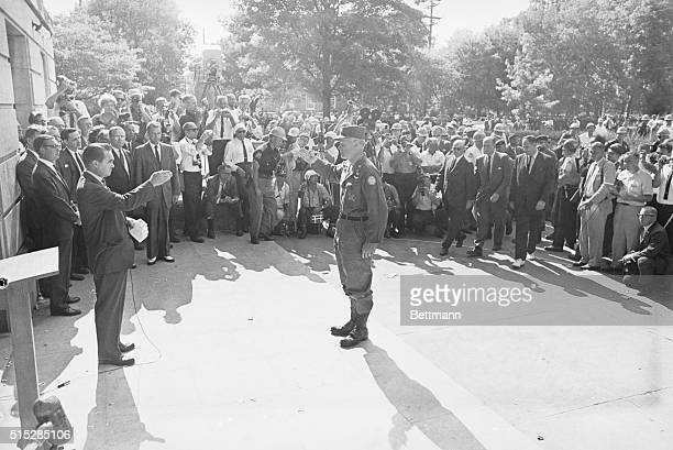 Brigadier General Henry V Graham officer in charge of federalized Alabama National Guard units salutes Alabama Governor George C Wallace at the...