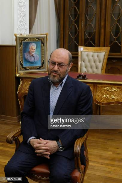 Brigadier General Hossein Dehghan adviser to the supreme leader of Iran sits in front of a framed portrait of Qassem Soleimani the commander of IRGC...