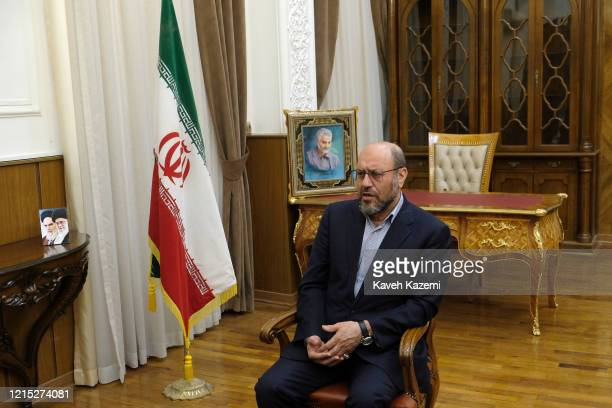 Brigadier General Hossein Dehghan adviser to the supreme6tju leader of Iran sits in front of a framed portrait of Qassem Soleimani the commander of...