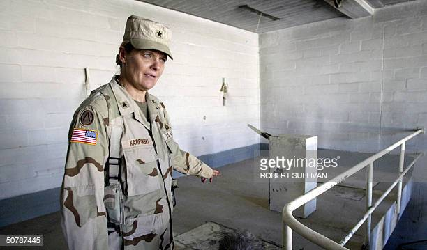 US Brigadier General Janis Karpinski stands before the gallows of the torture chamber inside the notorious Abu Gharib prison 16 September 2003 in...