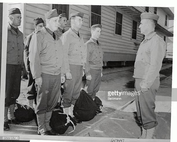 Brigadier General John McMahon Division Artillery Officer of the reactivated 77th Division as he looks over six selectees on their arrival at Fort...