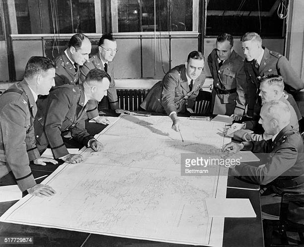 Brigadier General Leonard T. Gerow, member of the U.S. Army General Staff, meets with members of his War Plans Division in his office at the War...