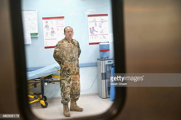 Brigadier General M Asif Bromand Commander Regional Medical CommandSoutheast looks in on a surgery at the Paktia Regional Military Hospital at...