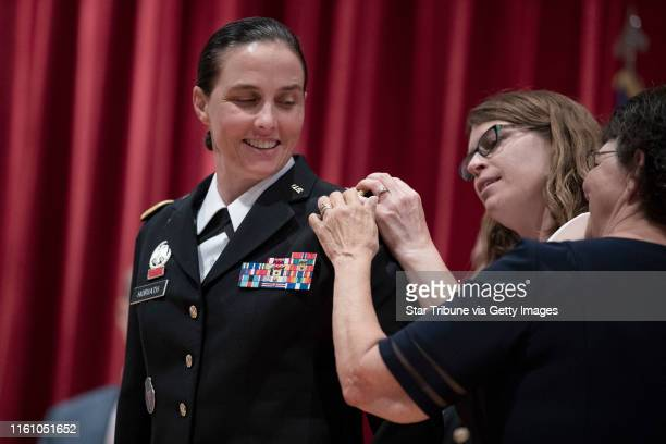 Brigadier General Stefanie Horvath had a star pinned on her uniform by wife Christy Starks and mother Catherin Horvath during a promotion ceremony...