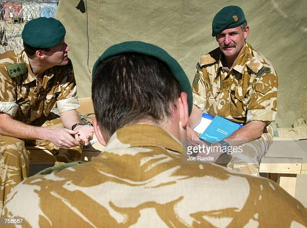 Brigadier Roger Lane of the British Royal Marines commando unit speaks with Lt Col Simon Wolsey and Lt Col Richard Watts during a briefing March 26...