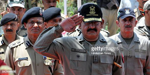 Brigadier Waseem of Chenab regiment Pakistan Rangers saluting BSF soldiers during a Guard of honor during the annual fair at the shrine of Sufi saint...