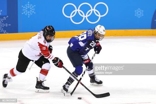 Brigette Lacquette of Canada and Amanda Kessel of the United States battle for the puck in the first period during the Women's Gold Medal Game on day...