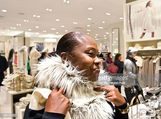 Brigette Scott who works in DC and lives in White Plains MD shops at the newly opened Ann Taylor store Thursday November 10 2011 in Washington DC...