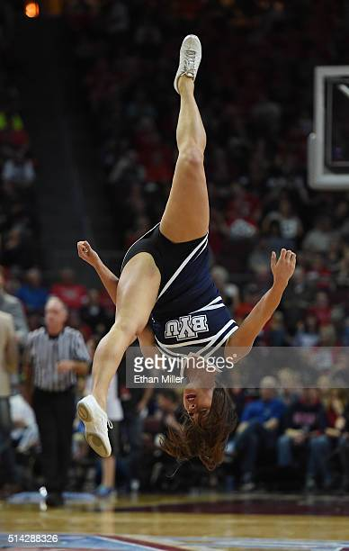 Brigham Young Cougars cheerleader flips in the air during the team's semifinal game of the West Coast Conference Basketball tournament against the...