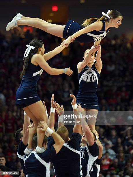 Brigham Young Cougars cheerleaders perform during the championship game of the West Coast Conference Basketball tournament against the Gonzaga...