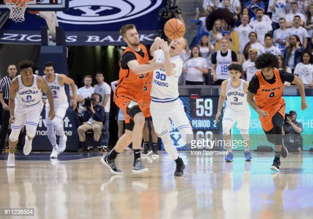 Brigham Young Cougars guard TJ Haws steals the ball from Pacific Tigers forward Jack Williams during a game between Pacific and BYU on January 27...